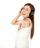 Pointing on you casual girl in headphones Royalty Free Stock Images