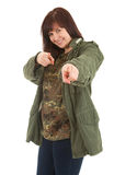 Pointing you fat young woman in militry jacket Royalty Free Stock Photography
