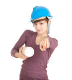 Pointing you female architect with blueprint Stock Photo