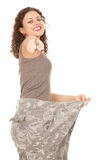 Pointing you girl in too great camouflage trousers Stock Photo