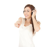 Pointing on you young woman in headphones Royalty Free Stock Image