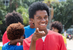 Pointing young african american man with friends Royalty Free Stock Photo