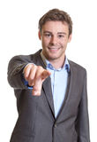 Pointing young businessman stock photo
