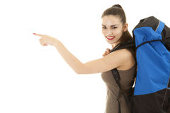 Pointing young female tourist with backpack Stock Photography