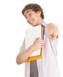 Pointing young male student with books Royalty Free Stock Photos