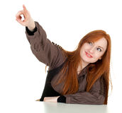 Pointing young red hair woman Stock Images