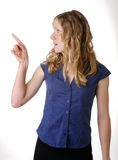 Pointing young woman. Half body profile of young woman pointing, white background Stock Images