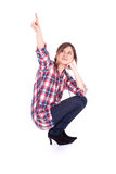 Pointing young woman Royalty Free Stock Photos