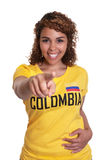 Pointing young woman from Colombia Royalty Free Stock Photo