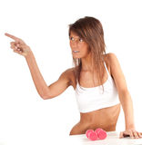 Pointing young woman with fitness weights Royalty Free Stock Images