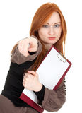 Pointing young woman keeping red clipboard Stock Image