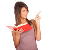 Pointing young woman with red book Royalty Free Stock Image