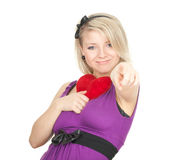Pointing young woman with small red heart Stock Photo