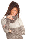 Pointing young woman in sweater Stock Photography
