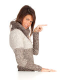 Pointing young woman in sweater Royalty Free Stock Photography