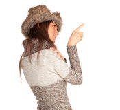 Pointing young woman in white winter hat Stock Photos