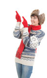Pointing young woman in winter clothes Royalty Free Stock Photos