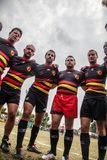 POINTNOIRE/CONGO - 18MAY2013 - Team of amateur friends playing rugby. Africa royalty free stock photo