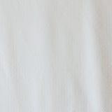 Points blancs sur la texture blanche de tissu Photos stock