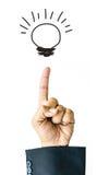 Points d'hommes d'affaires de main à dessiner l'ampoule Photographie stock libre de droits