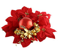 Pointsettia and Candle. Red Christmas Candle in circle of Pointsettias with gold bell decoration royalty free stock photo