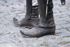 Pointy medieval shoes. Close up view of a pair of pointy medieval shoes stock photos
