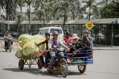 Workers transport goods by cart Stock Image