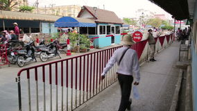 POIPET BORDER CROSSING,THAILAND,CAMBODIA - FEBRUARY 2014: people at border stock footage