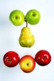 Poire entre les pommes Photos libres de droits