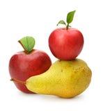 Poire et pommes rouges Image libre de droits