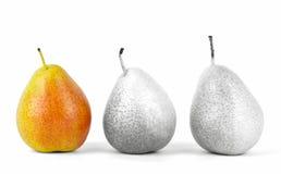 3 poires dans une rangée Photographie stock libre de droits