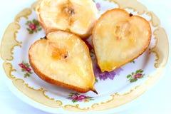 Poires et pommes cuites au four Images libres de droits