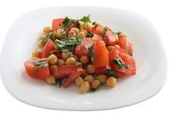 Pois chiche de salade avec la tomate Photo stock