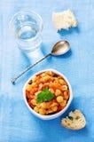 Pois chiches avec des légumes et le pangasius Image stock
