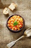 Pois chiches avec des légumes et le pangasius Photo stock