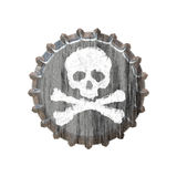 Poison Bottle Cap. A bottle cap with a skull and crossbones great for concepts of alcohol abuse or addiction Stock Images