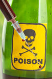 Poison bottle with label and blood stock photo