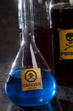 Poison bottle with label Royalty Free Stock Photo