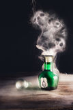 Poison bottle on a table royalty free stock images