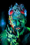 Poison Ivy, Element Earth. Body art glowing in ultraviolet light Stock Images