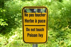 Poison Ivy warning sign in forest Stock Photos