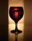 Poison Wine. Wine glass containing Red wine and a drop of Ink Stock Image