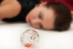 Poisoned  brunette lying on the floor. Crime scene simulation: poisoned  brunette lying on the floor (selective focus Stock Photo