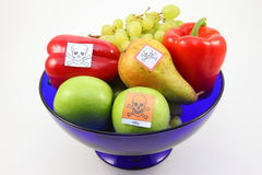 Poisoned fruits and vegetables. By Pestiziede poisoned fruit and vegetables in a fruit bowl-cut out Royalty Free Stock Images