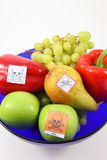 Poisoned fruits and vegetables. By Pestiziede poisoned fruit and vegetables in a fruit bowl-cut out Stock Images