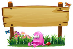 A poisoned pink monster under empty signboard Royalty Free Stock Photos