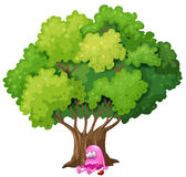 A poisoned pink monster under the tree Royalty Free Stock Photo
