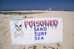 Poisoned sign. On the  beach Stock Images