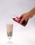 Poisoning. Put poison in the pearl milk tea Stock Photos