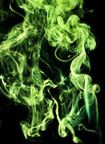 Poisonous chemical fumes. Texture green toxic smoke on a black background Royalty Free Stock Images